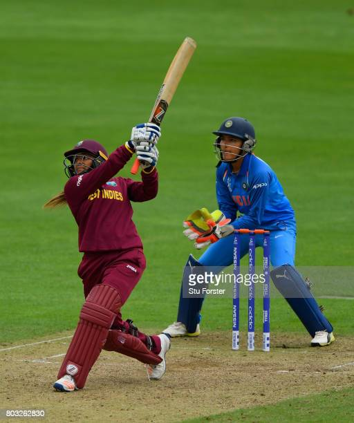 West Indies player Anisa Mohammed hits out watched by India wicketkeeper Sushma Verma during the ICC Women's World Cup 2017 match between West Indies...