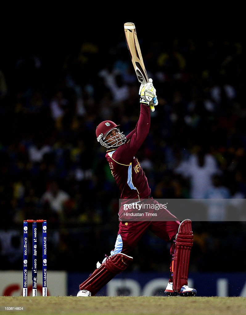 West Indies player <a gi-track='captionPersonalityLinkClicked' href=/galleries/search?phrase=Marlon+Samuels&family=editorial&specificpeople=185235 ng-click='$event.stopPropagation()'>Marlon Samuels</a> hits a six during the ICC World T20 cricket Final between Sri Lanka and West Indies at R. Premadasa Stadium on October 7, 2012 in Colombo, Sri Lanka.