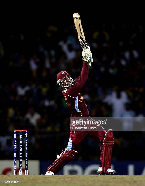 West Indies player Marlon Samuels hits a six during the ICC World T20 cricket Final between Sri Lanka and West Indies at R Premadasa Stadium on...