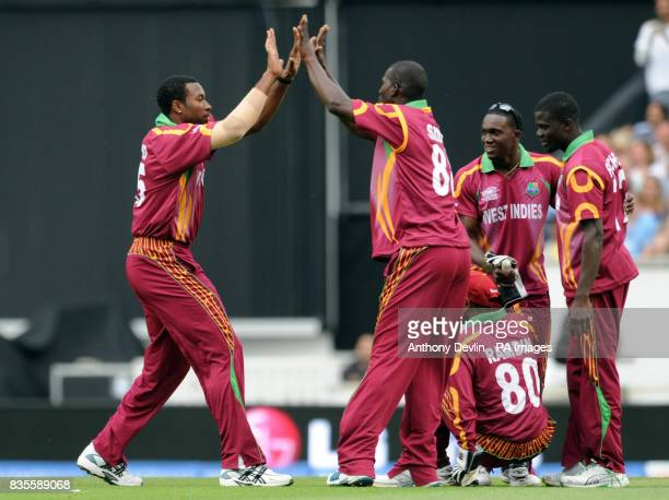 West Indies players celebrate after England's Luke Wright is caught by Denesh Ramdin for 6 off the bowling of Kieron Pollard during the ICC World...