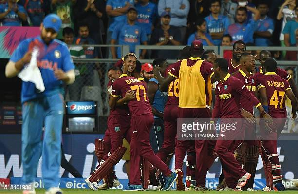 West Indies players celebrate after winning the World T20 cricket tournament semifinal match against India at The Wankhede Cricket Stadium in Mumbai...