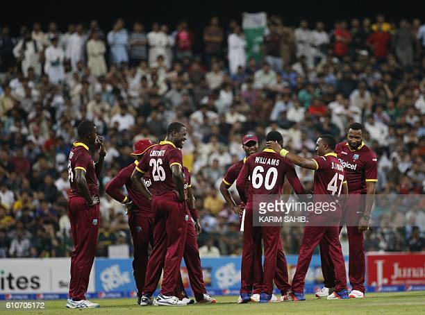 West Indies' players celebrate with his teammates after bowling out Pakistan's Khalid Latif during the T20I match between Pakistan and West Indies at...