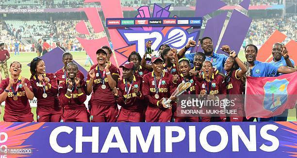 West Indies players celebrate with the trophy after winning the World T20 cricket tournament women's final match between Australia and West Indies at...