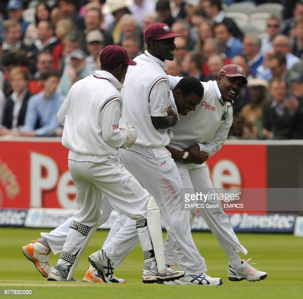 West Indies players help Shannon Gabriel celebrate taking his first test wicket of England's Matt Prior