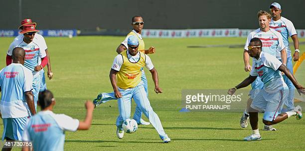 West Indies players play football during a training session at The ShereBangla National Cricket Stadium in Dhaka on March 31 2014 West Indies plays...