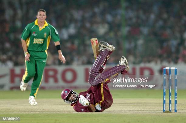 West Indies' Ramnaresh Sarwan takes evasive action from a Bouncer from South Africa's Andre Nel during the ICC Champions Trophy semifinal match at...