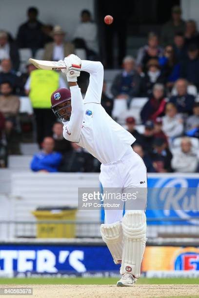 West Indies' Roston Chase bats to lose his wicket for 30 off the bowling of England's Chris Woakes and caught by England's Mason Crane on the fifth...