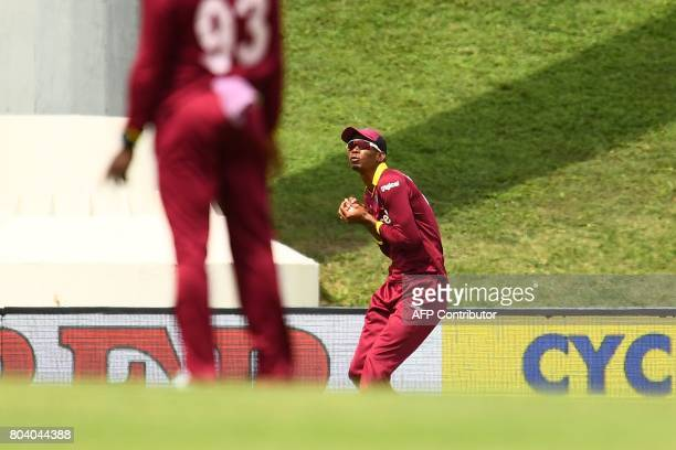West Indies' Roston Chase catches the ball to dismiss India's Shikhar Dhawan during the third One Day International match between West Indies and...