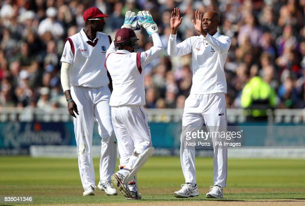 West Indies' Roston Chase celebrates the wicket of England's Dawid Malan for 65 during day two of the First Investec Test match at Edgbaston...