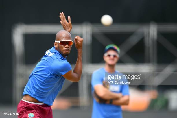 West Indies' Roston Chase delivers a ball during a practice session at the Queen's Park Oval in Port of Spain Trinidad on June 22 ahead of the first...