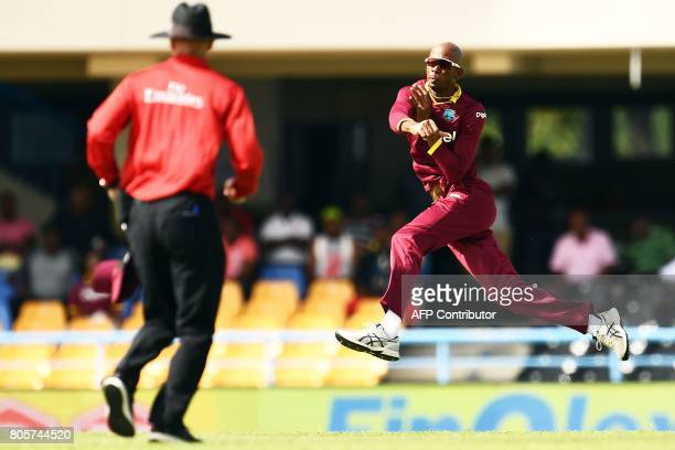 West Indies' Roston Chase fields the ball during the fourth One Day International match between West Indies and India at the Sir Vivian Richards...