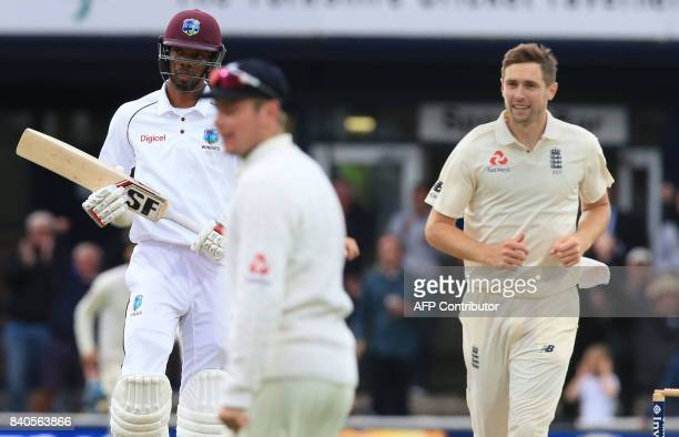 West Indies' Roston Chase leaves the crease after losing his wicket for 30 off the bowling of England's Chris Woakes and caught by England's Mason...