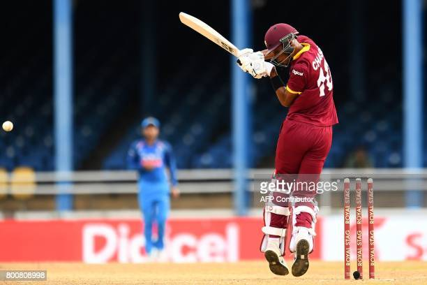 West Indies' Roston Chase plays a shot during the second One Day International match between West Indies and India at the Queen's Park Oval in Port...