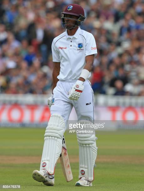 West Indies' Roston Chase walks back to the pavilion after losing his wicket during play on day 3 of the first Test cricket match between England and...