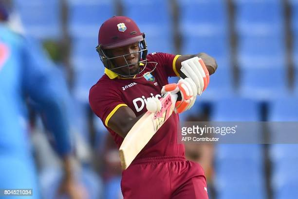 West Indies' Rovman Powell plays a shot during the third One Day International match between West Indies and India at the Sir Vivian Richards Cricket...