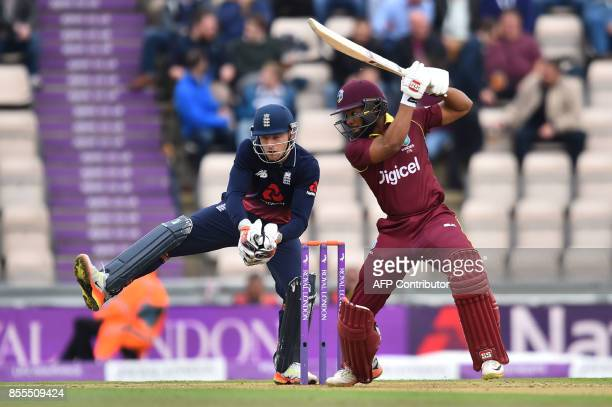 West Indies' Shai Hope bats as England's Jos Buttler looks on during the final OneDay International cricket match between England and the West Indies...