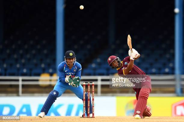 West Indies' Shai Hope hits a boundary during the second One Day International match between West Indies and India at the Queen's Park Oval in Port...