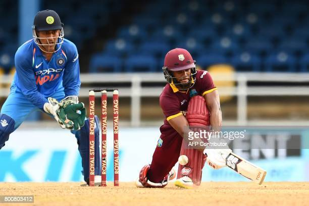 West Indies' Shai Hope plays a shot off India's Kuldeep Yadav to be LBW during the second One Day International match between West Indies and India...