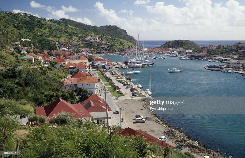 West Indies St Barthelemy Gustavia View over the port with yachts on water and houses built along bottom of hillside