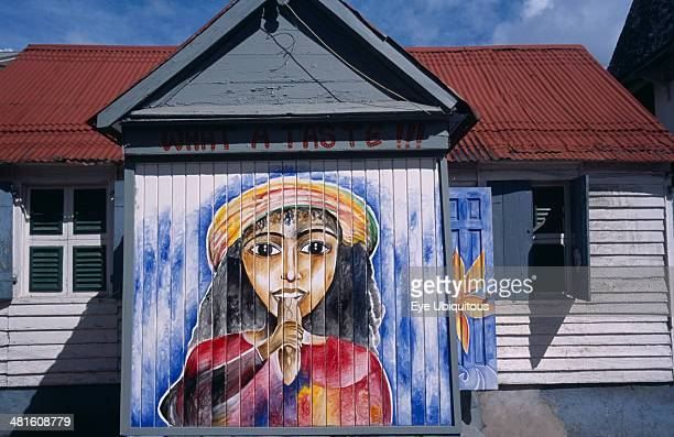 West Indies Windward Islands Dominica Roseau Mural on exterior of bread shop in the centre of the capital