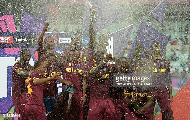 TOPSHOT West Indies's captain Darren Sammy holds the trophy after winning the World T20 cricket tournament final match between England and West...