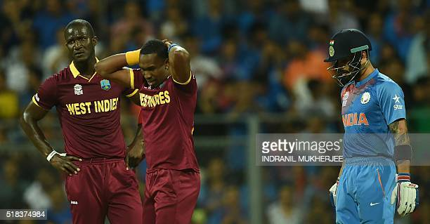 West Indies's captain Darren Sammyand teammate Dwayne Bravoreact after failing to run out India's Virat Kohliduring the World T20 cricket tournament...