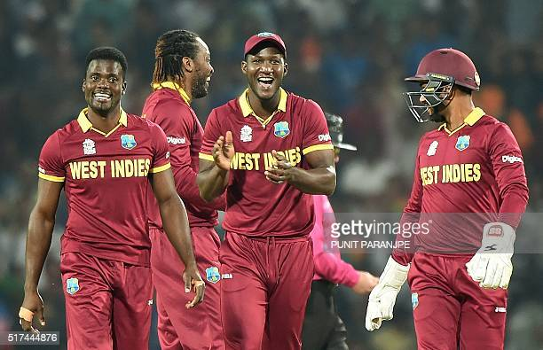 West Indies's captain Darren Sammycelebrates with teammates after the wicket of South Africa's batsman Rilee Rossouw during the World T20 cricket...