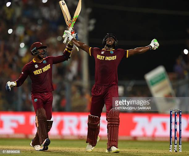 West Indies's Carlos Brathwaiteand teammate Marlon Samuels celebrate after victory in the World T20 cricket tournament final match between England...