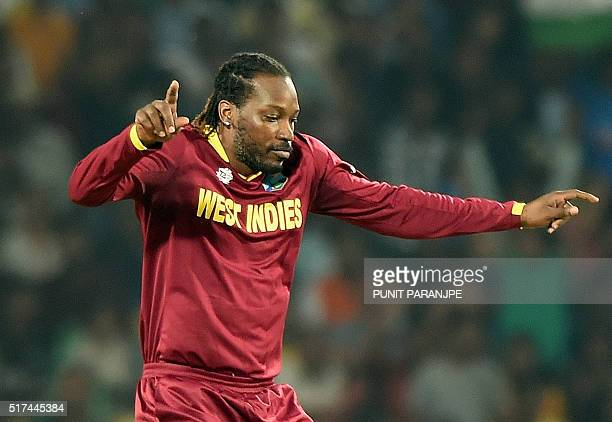 West Indies's Chris Gayle celebrates after taking the wicket of South Africa's batsman Rilee Rossouw during the World T20 cricket tournament match...