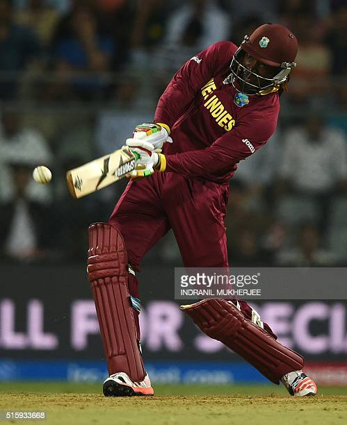 West Indies's Chris Gayle plays a shot during the World T20 cricket tournament match between England and West Indies at The Wankhede Cricket Stadium...