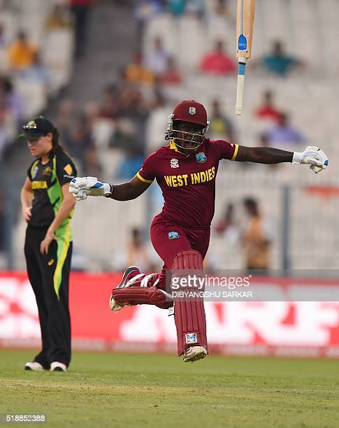 West Indies's Deandra Dottin celebrates after victory in the World T20 cricket tournament women's final match between Australia and West Indies at...