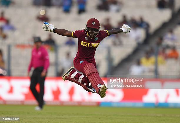 TOPSHOT West Indies's Deandra Dottin celebrates after victory in the World T20 cricket tournament women's final match between Australia and West...