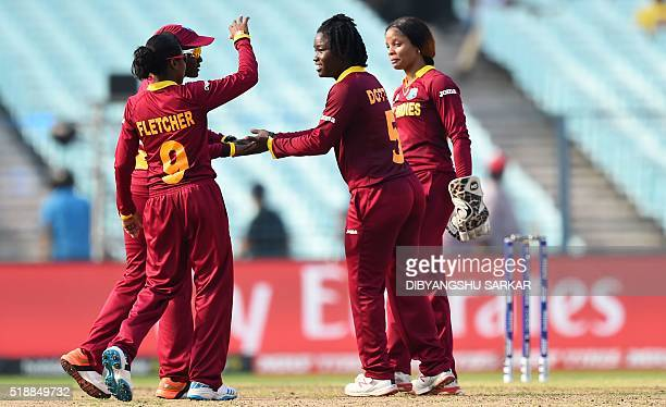 West Indies's Deandra Dottincelebrates with teammates after the dismissal of Australia's Ellyse Perry during the World T20 cricket tournament women's...