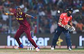 West Indies's Dwayne Bravo celebrates the wicket of England's Moeen Ali during the World T20 cricket tournament final match between England and West...