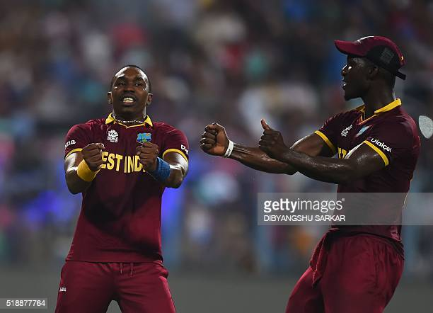 West Indies's Dwayne Bravocelebrates with captain Darren Sammy after the wicket of England's Moeen Ali during the World T20 cricket tournament final...