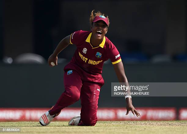 West Indies's Hayley Matthews celebrates after taking a catch off her own bowling to dismiss Australia's Alyssa Healy during the World T20 cricket...