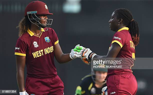 West Indies's Hayley Matthewsand West Indies's Stafanie Taylor pump fists during the World T20 cricket tournament women's final match between...