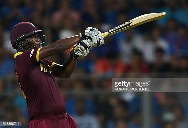 West Indies's Johnson Charles plays a shot during the World T20 men's semifinal match between India and West Indies at The Wankhede Cricket Stadium...
