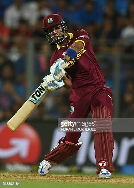 West Indies's Lendl Simmons plays a shot during the World T20 men's semifinal match between India and West Indies at The Wankhede Cricket Stadium in...