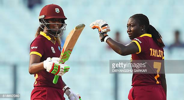 West Indies's Stafanie Taylorlooks on as Hayley Matthews celebrates after scoring a halfcentury during the World T20 cricket tournament women's final...