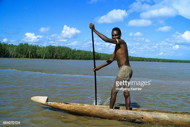 West Irian Jaya Asmat Region Tribesman In Dugout Canoe