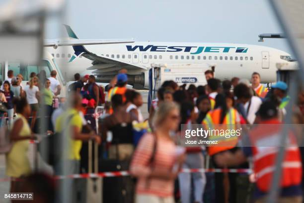 West Jet plane is about to depart as evacuation procedures by US Embassy personnel continue at Princess Juliana Airport on September 11 2017 in...