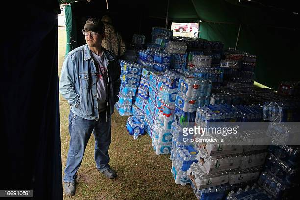 West native and Texas AM theater teacher Justin A Miller helps distribute donated bottles of water outside the West Community Center the day after...