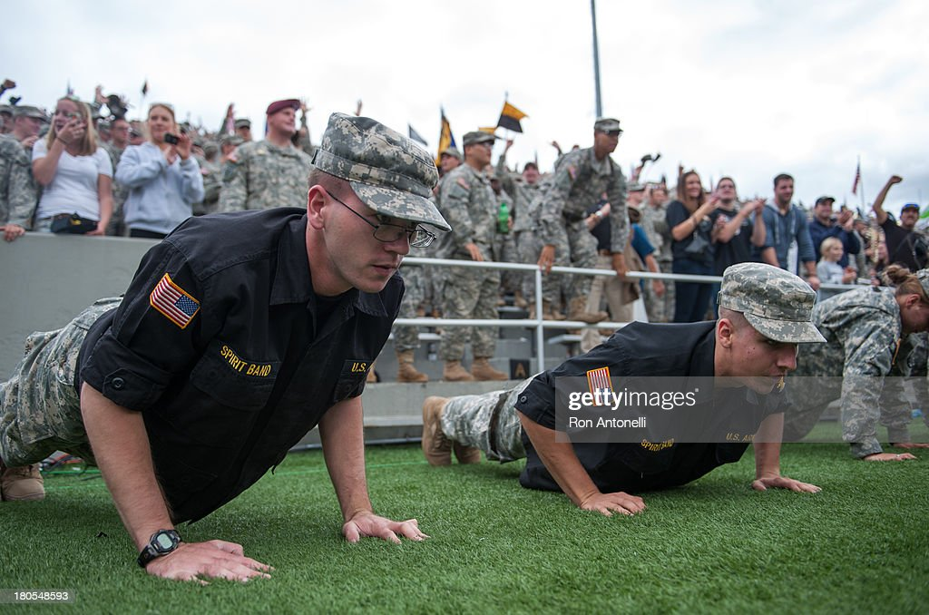 West Point Cadets do push ups as they celebrate after a touchdown in the 1st half September 14 2013 at Michie Stadium in West Point New York Stanford...