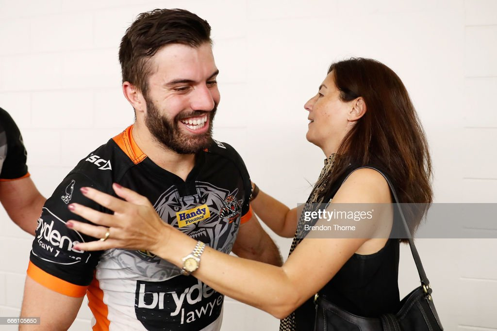 West Tigers Chairwomen, Marina Go hugs James Tedesco of the Tigers following the round six NRL match between the North Queensland Cowboys and the Wests Tigers at 1300SMILES Stadium on April 8, 2017 in Townsville, Australia.