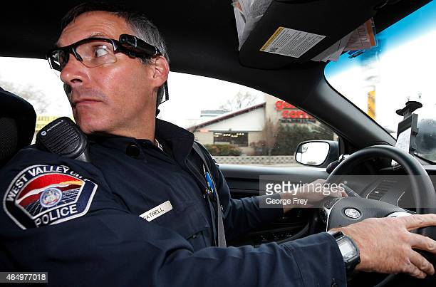 West Valley City patrol officer Gatrell goes on patrol in his car on the first day of use of his newlyissued body camera attached to the side of a...
