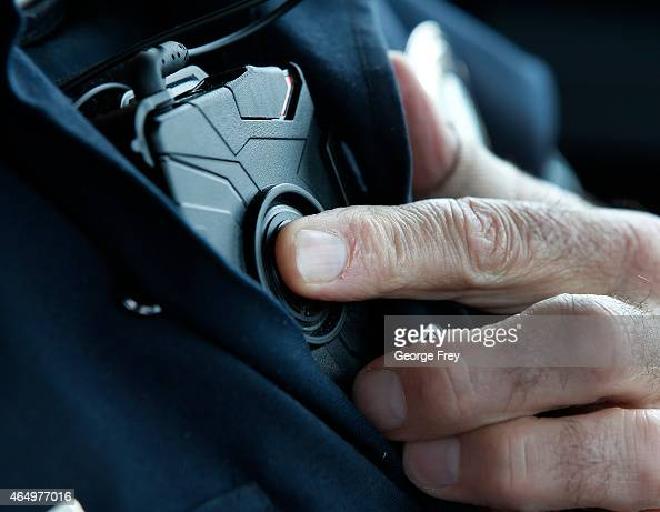 West Valley City patrol officer Gatrell starts a body camera recording by pressing a button on his chest before he takes a theft report from a...