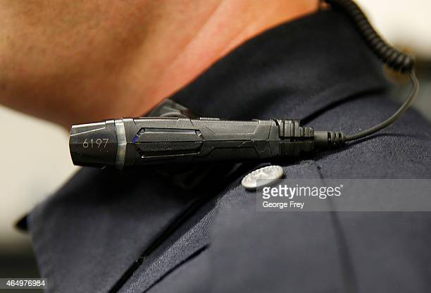 West Valley City police officer shows off a newlydeployed body camera attached to his shirt collar on March 2 2015 in West Valley City Utah West...