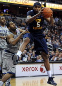 West Virginia forward Kevin Jones pulls down a rebound against Georgetown guard Austin Freeman left during firsthalf action at the Verizon Center in...