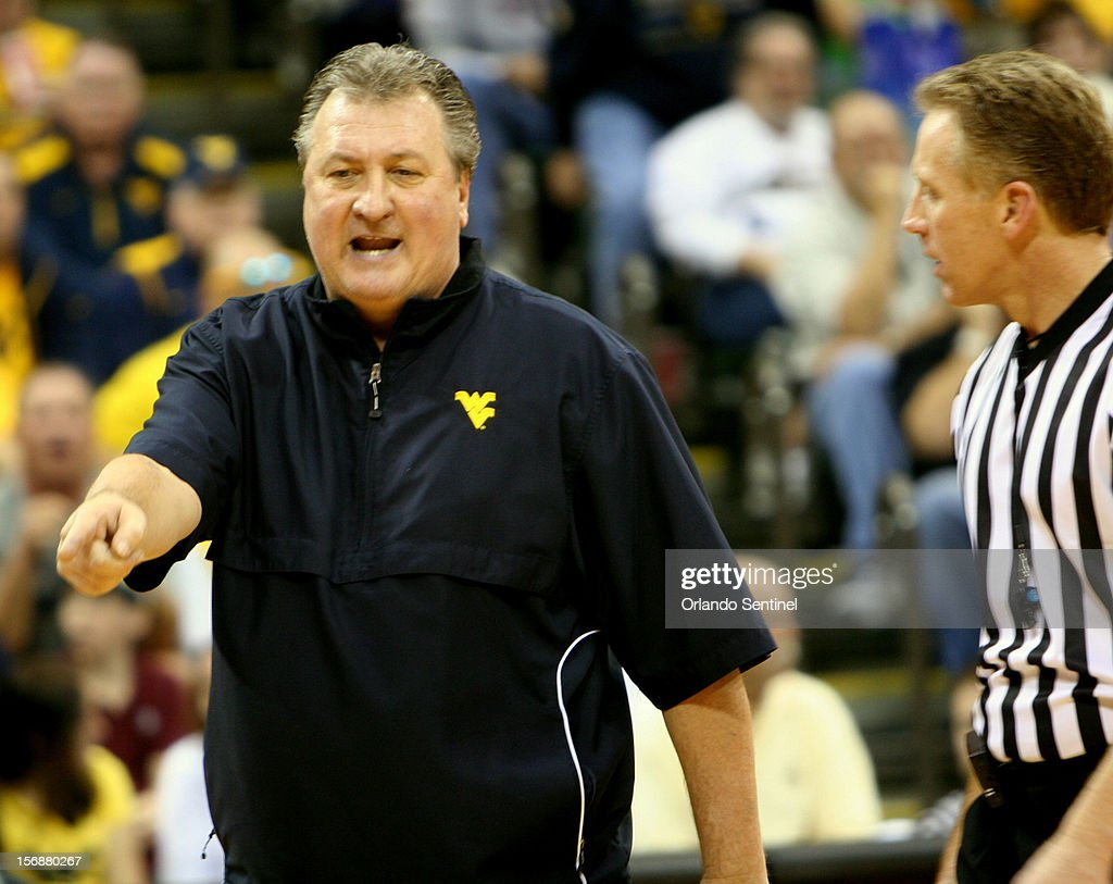 West Virginia head coach Bob Huggins speaks with an official during a 63-60 loss to Davidson in the Old Spice Classic semifinals at the HP Field House in Lake Buena Vista, Florida, on Friday, November 23, 2012.